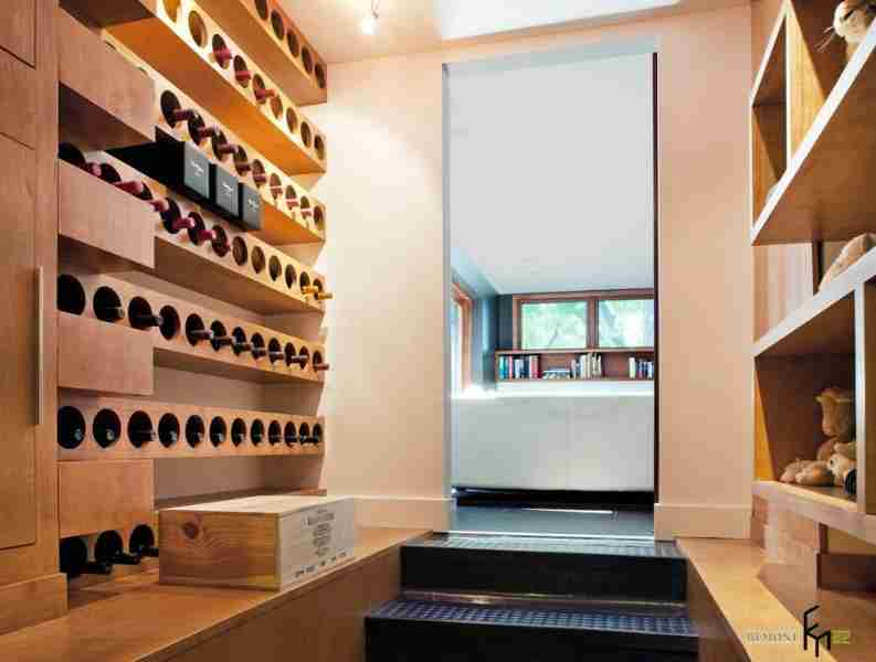Unique design for modern wine cellar with special storage constructions of light wood