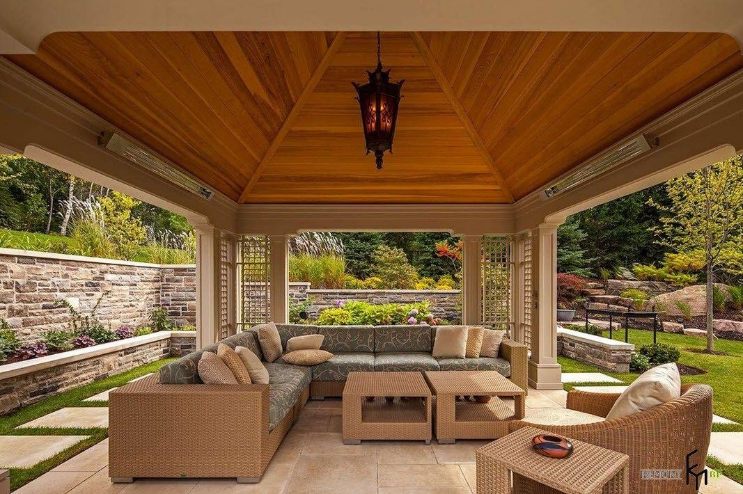 Cozy designed contemporary gazebo with soft angular sofa and coffee table