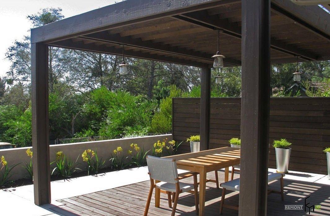 Backyard and Garden Gazebo: Design, Form, Use and Practical Advice. Dark wooden modern styled gazebo on the platform