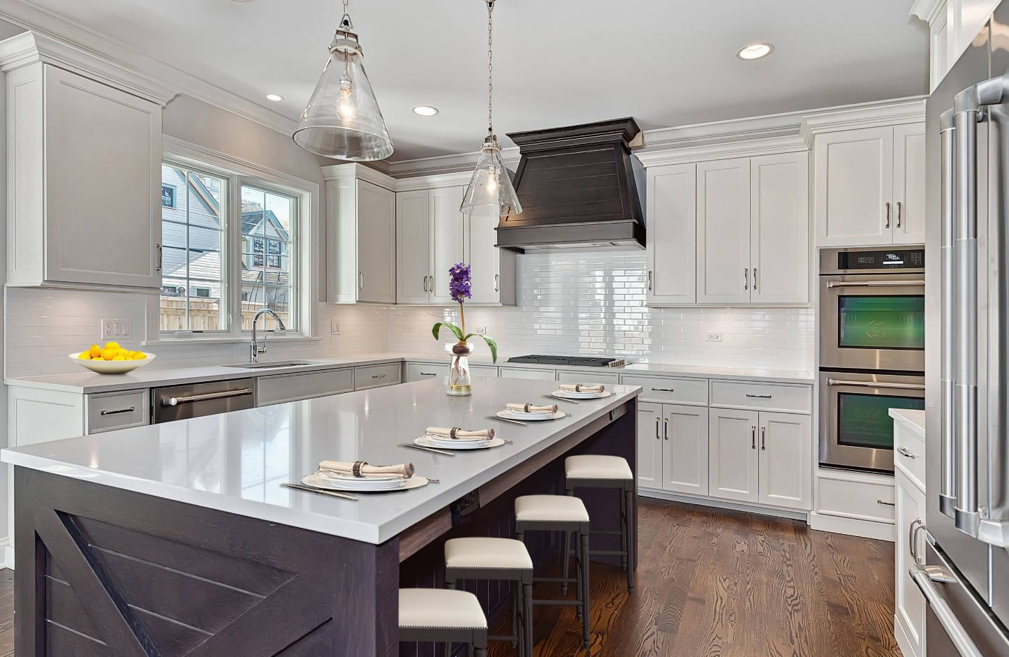 160 Square Feet Kitchen Design Ideas. Dark extractor hood and glossy white countertop of the classic kitchen