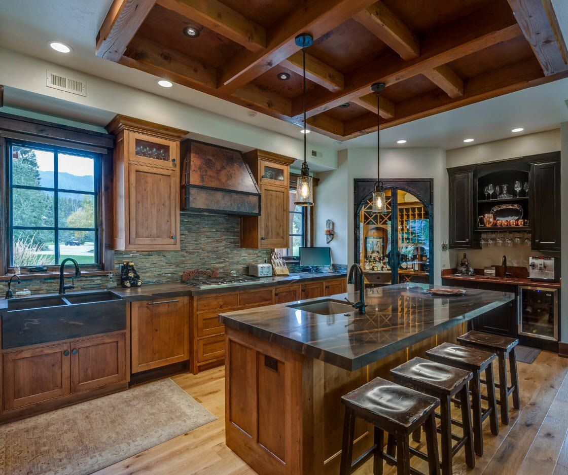Gray granite glossy countertop and coffered ceiling for the classic designed kitchen