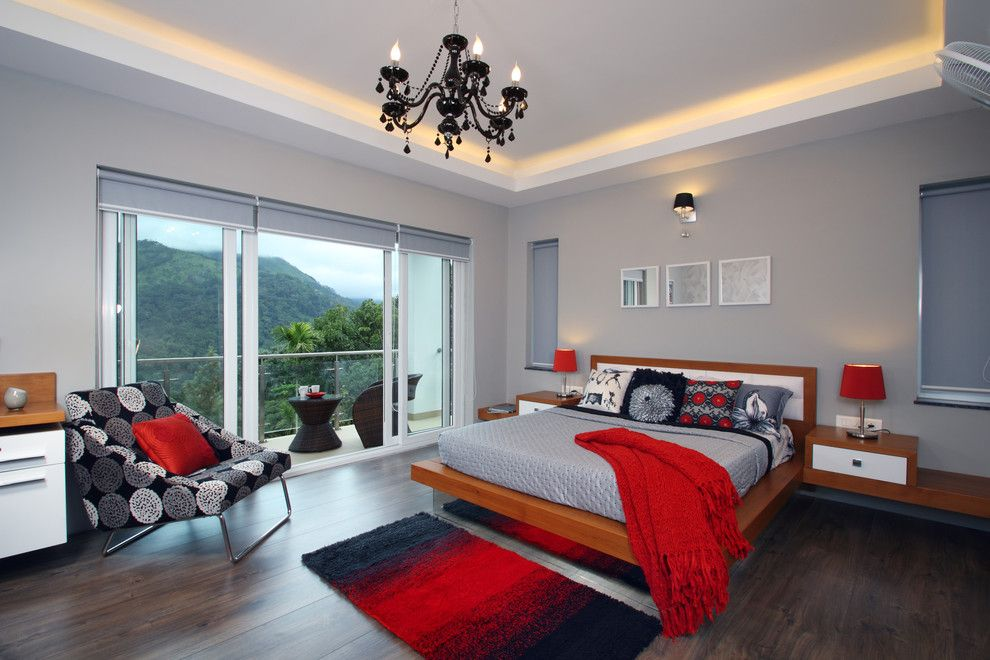 150 Square Feet Bedroom Interior Decoration and Photos. Red color to revive gray painted atmosphere of the classic room