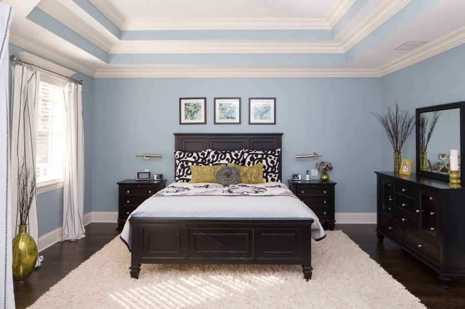 Blue color painted walls for Classic bedroom with black wooden bed
