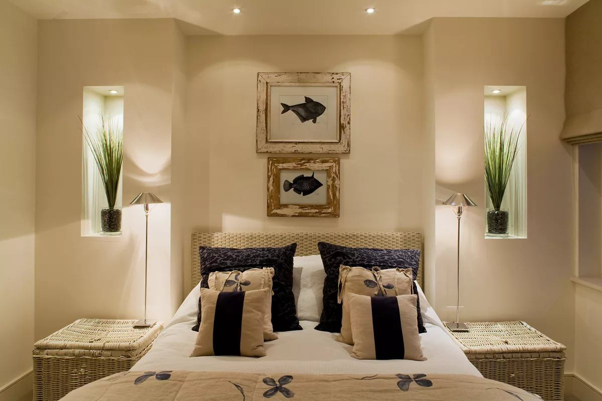 Beige colored walls in the casual styled bedroom decorated with pictures
