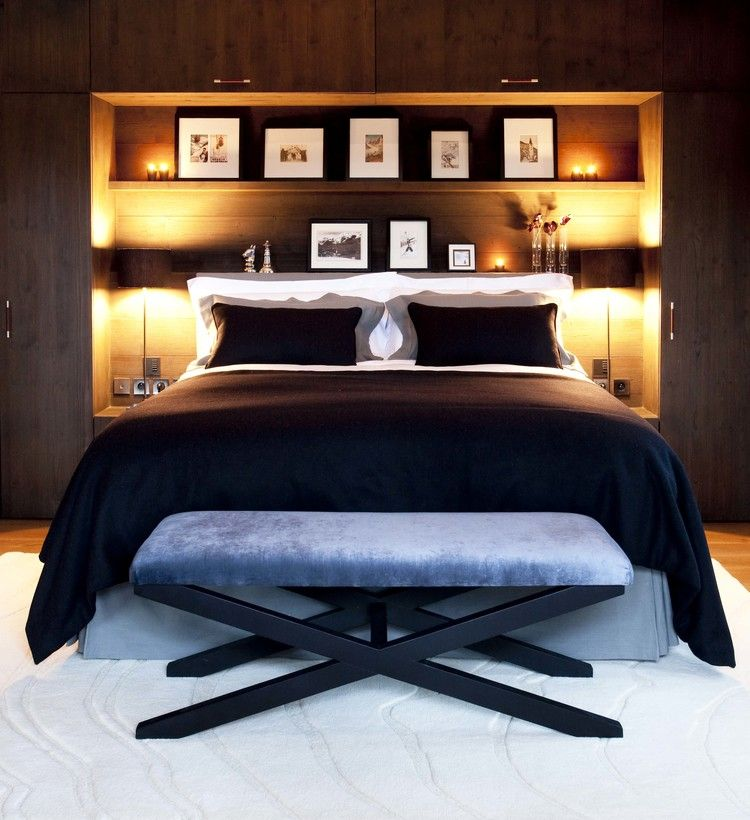 Niche in the Room: Recess in the Wall for Decoration and Functionality. Japanese style of the bedroom in dark tones and additional lighting of the headboard storage