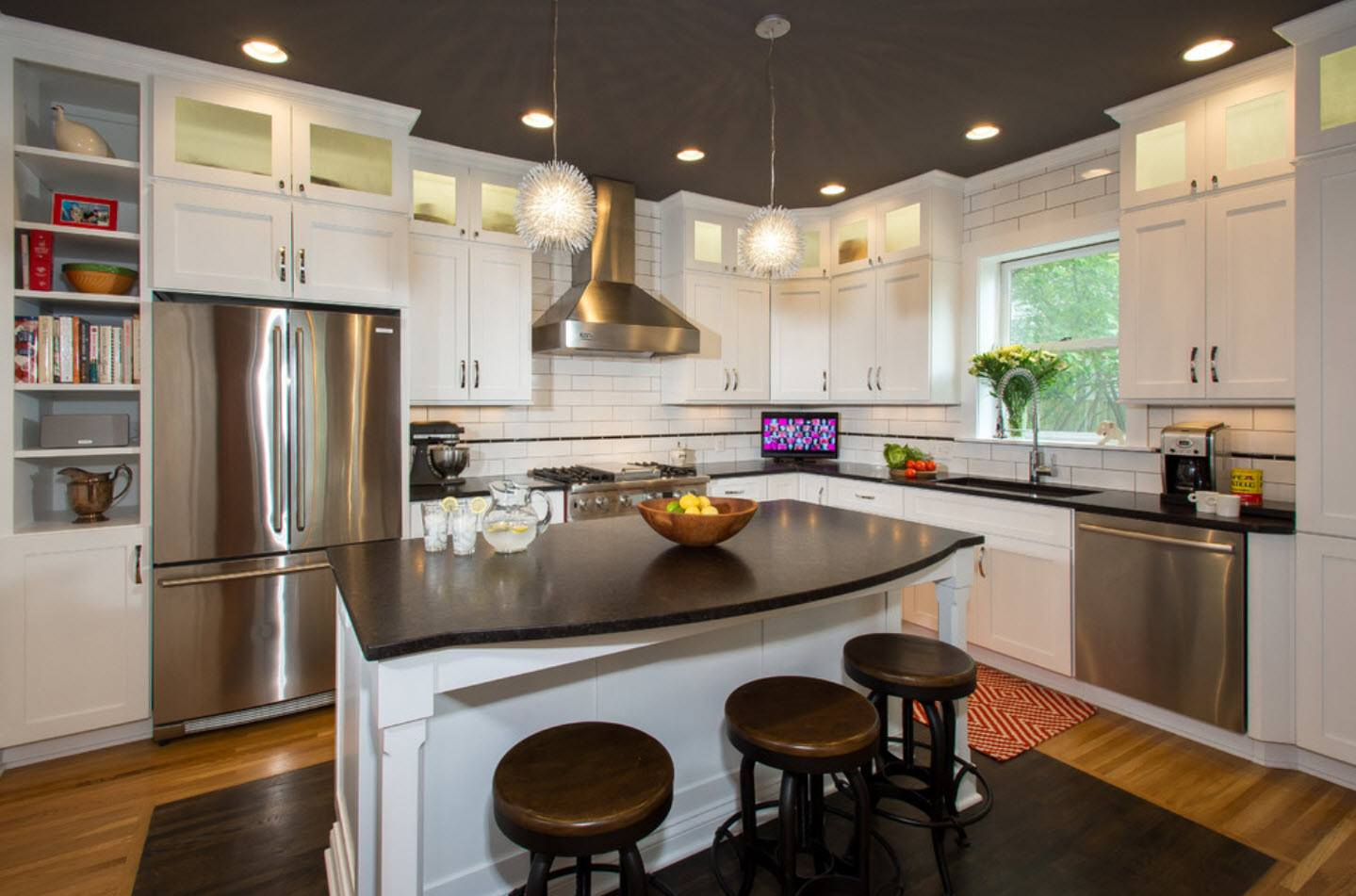 120 Square Feet Kitchen Interior Design Ideas with Photos. Black round chairs in the Classic designed area with dark ceiling