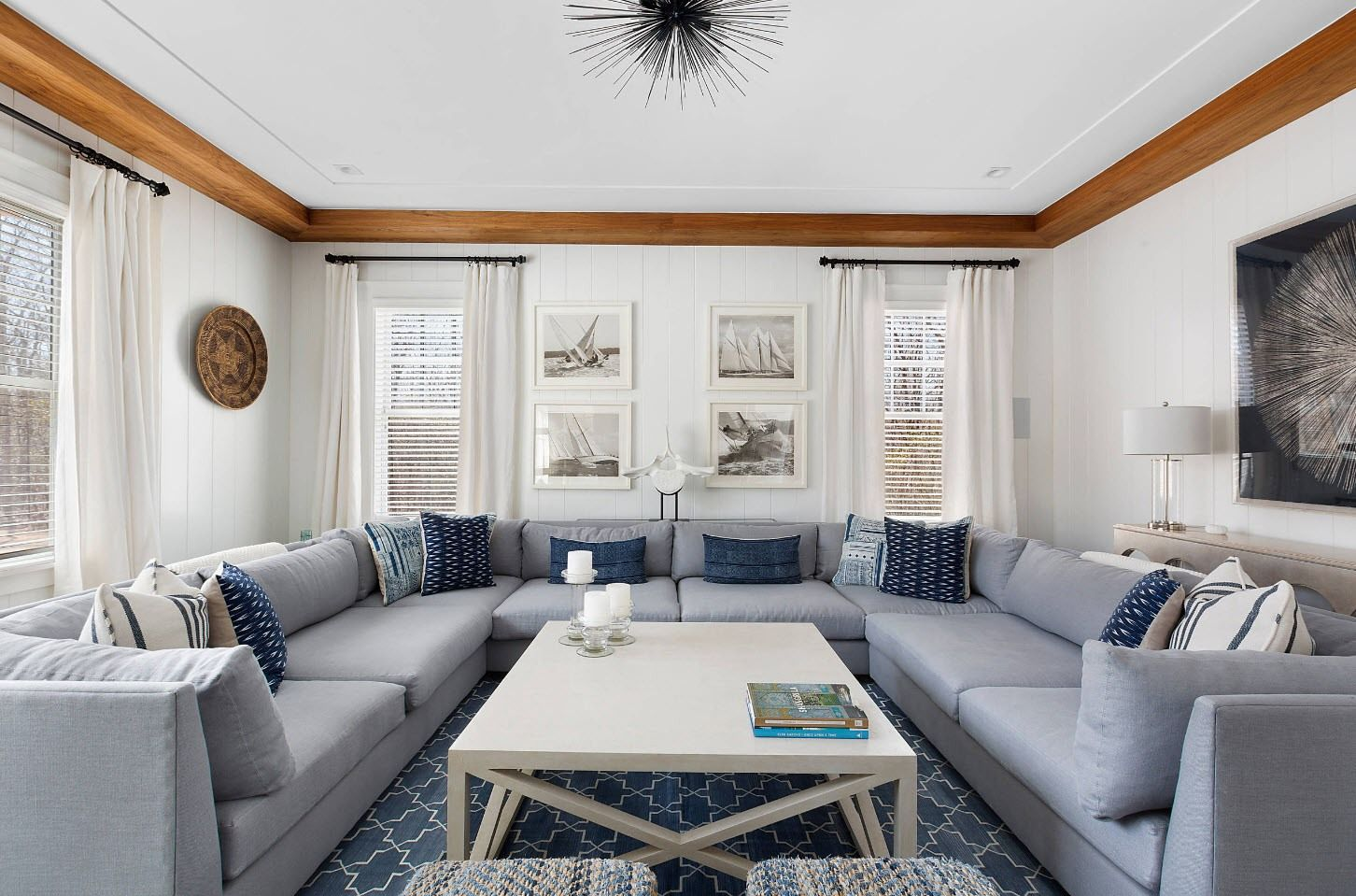 Wooden trimmed transition in the living room with u-shaped upholstered sofa