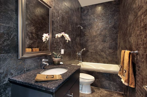 Graphite colored bathroom with white plumbing
