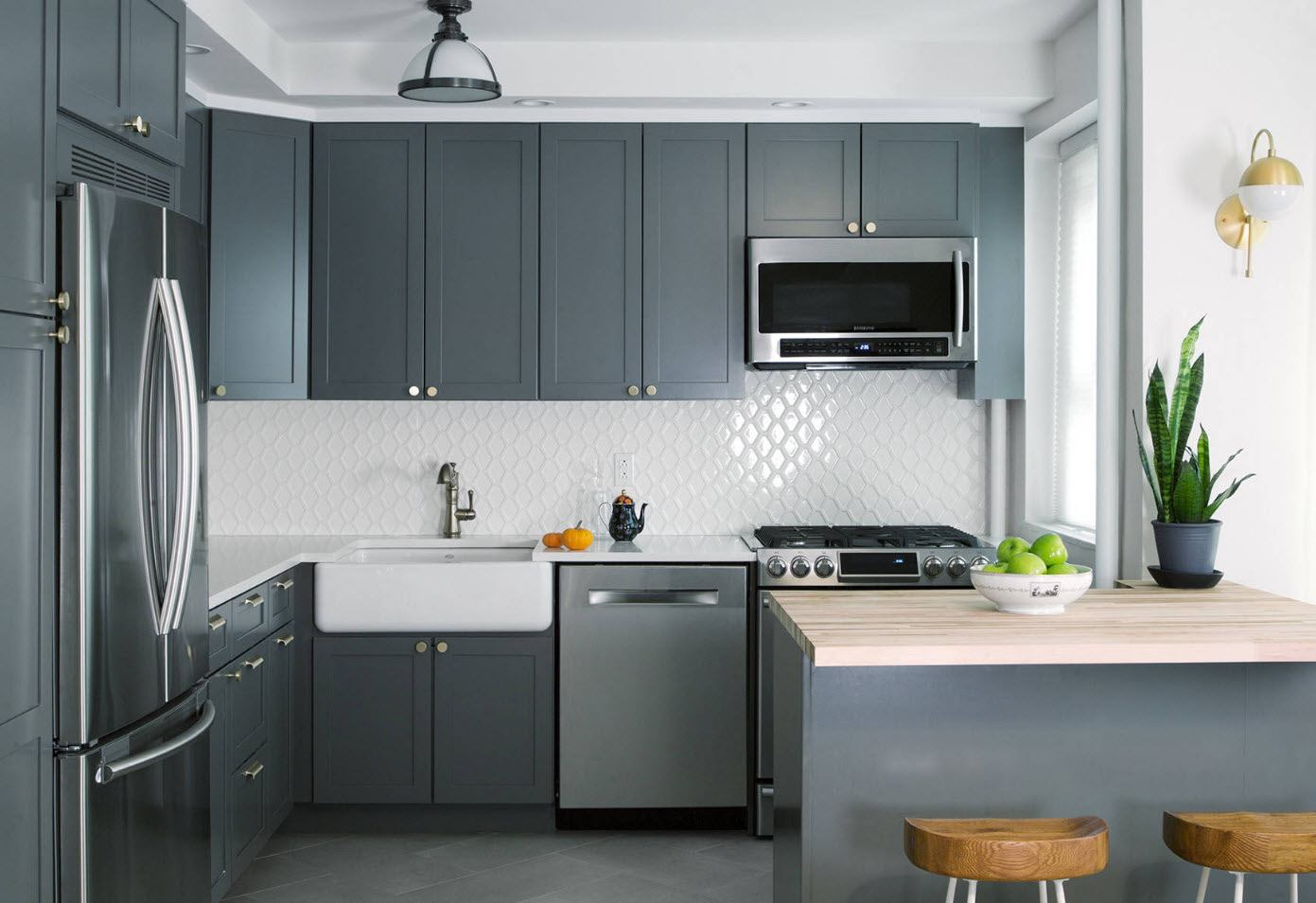 Gray kitchen facades of modular designed cabinets