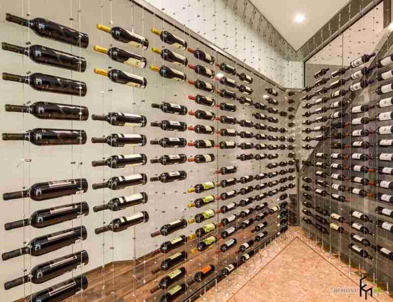 Numerous bottles at the metal framed open shelving