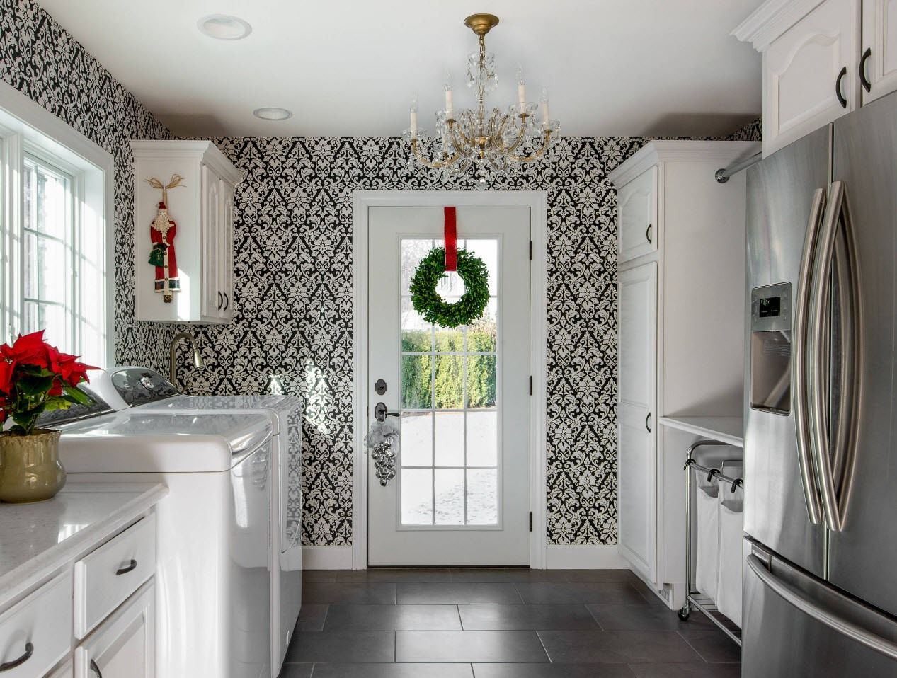Kitchen with the entrance to the backyard and contrasting wallpaper