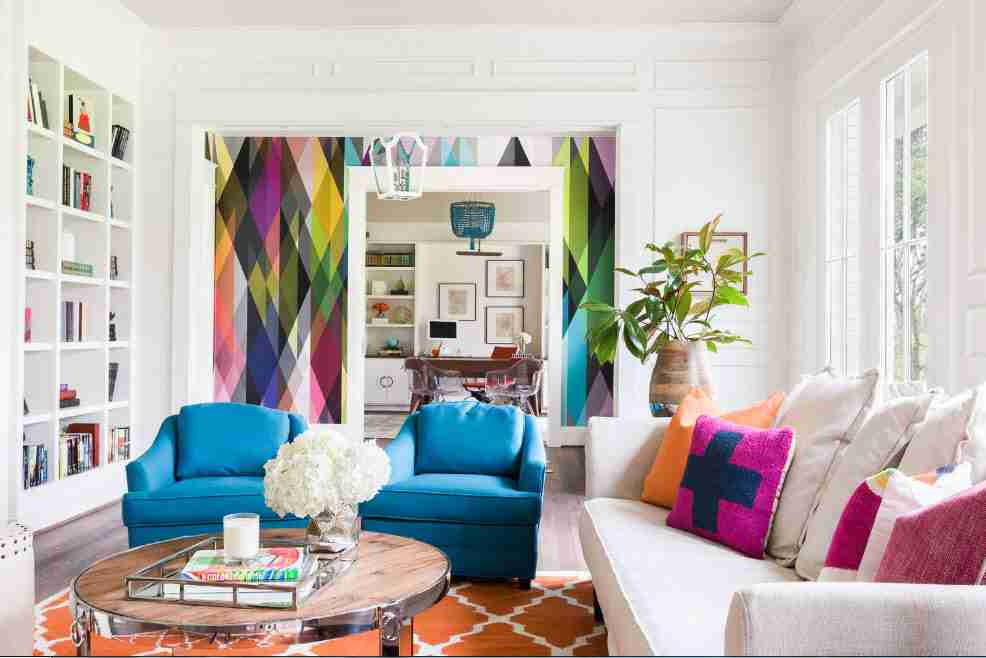 White designed living room in pop-art style with colorful painted wall inlays