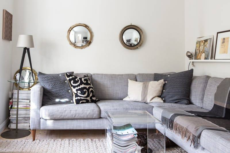 130 Square Feet Living Room most Effective Design Ideas. Two small round mirrors above the angular sofa