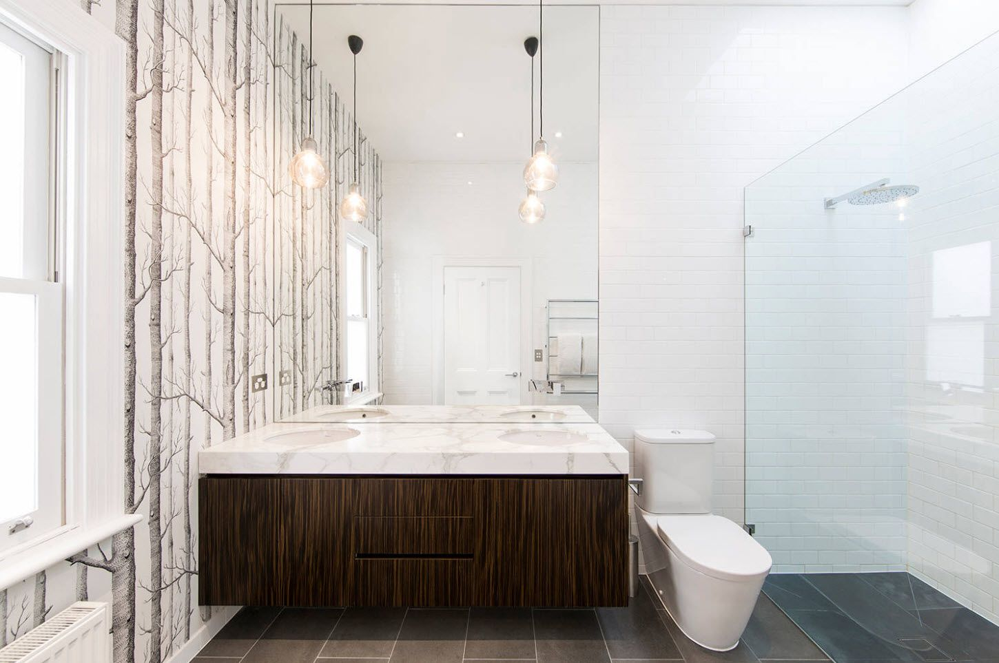 Modern bathroom design with suspended wooden vanity and naturalistic wallpaper design