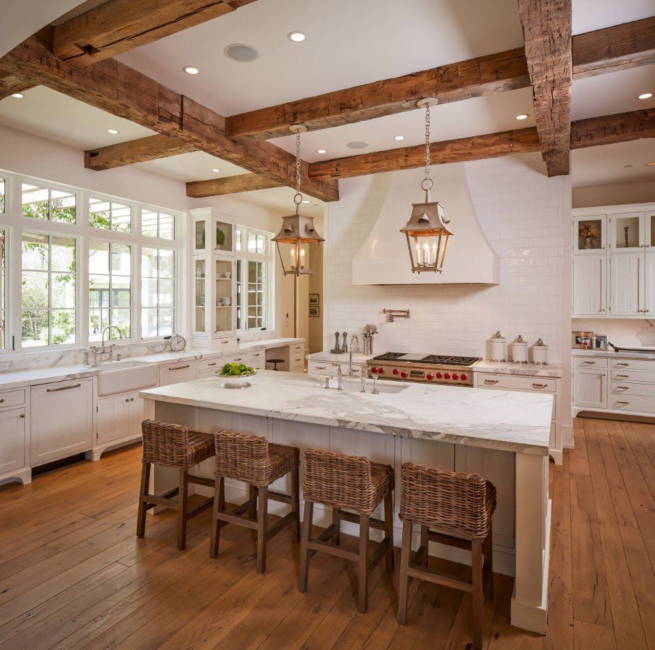Open ceiling beams in the wooden trimmed classic kitchen with white wall paint