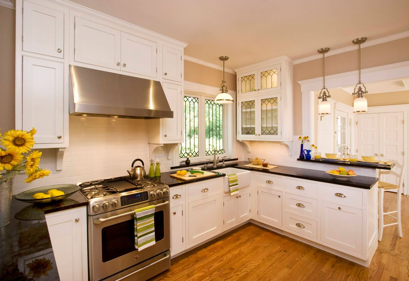 Classic kitchen in white with exposed steel luster of appliances