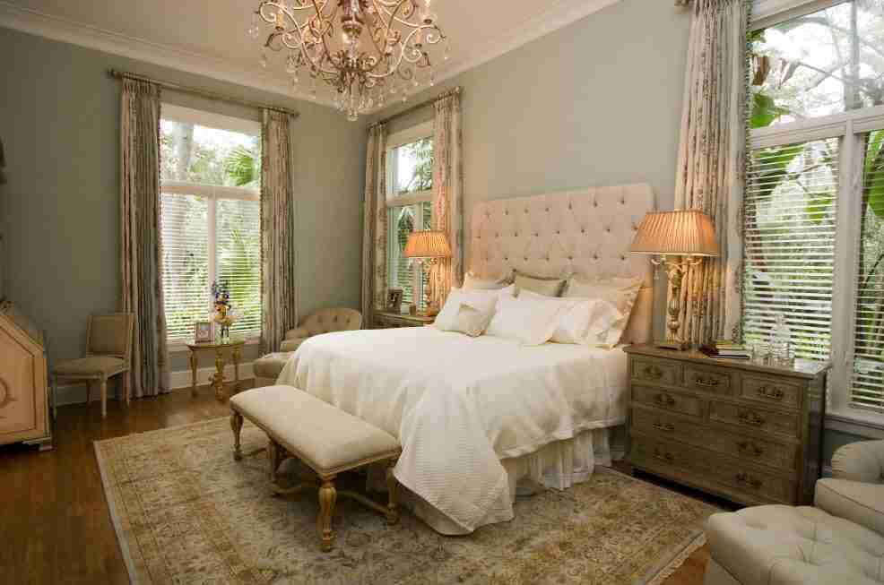 Pale blue finished walls and crystal chandelier in the Classic bedroom