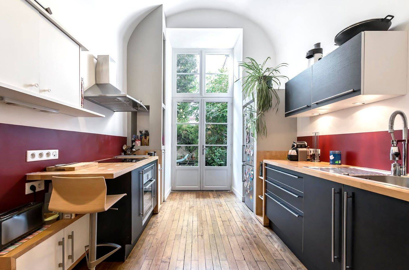 Galley kitchen with two sides of black furniture