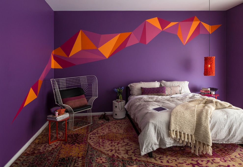 Graphity decorated accent wall in bright colors and the carpet in the bedroom