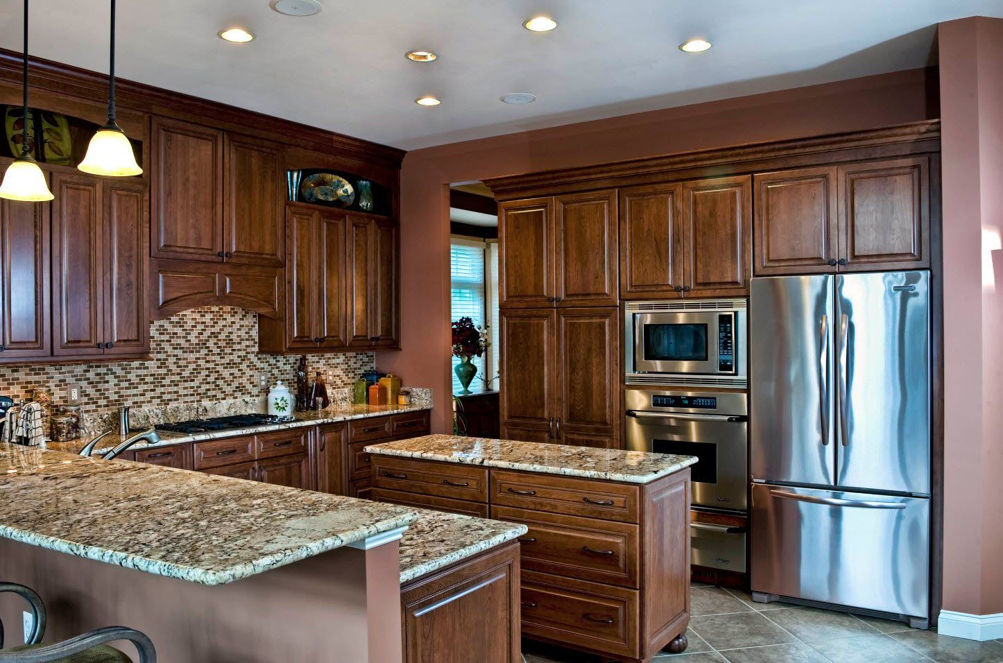 Oak trimmed and carved kitchen gacades and marble top of the island and butcher block