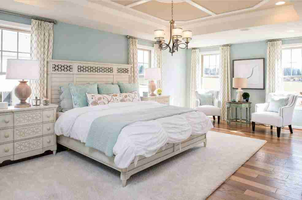 Coffered ceiling in the typical classic interior design of the bedroom with pale blue walls