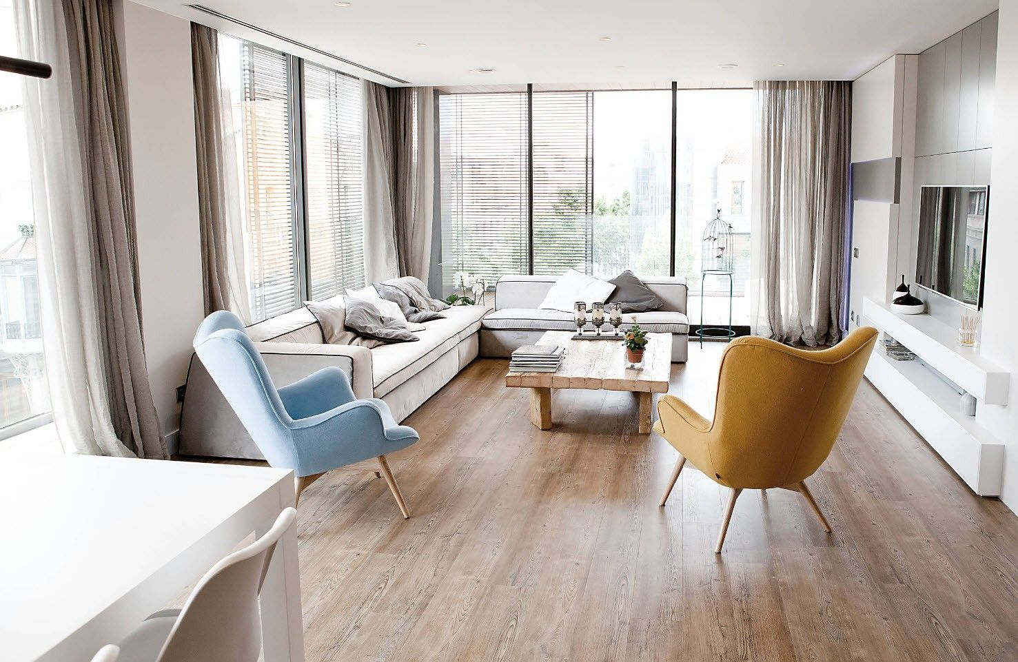 Contemporary Scandi style for sun lit open layout apartment