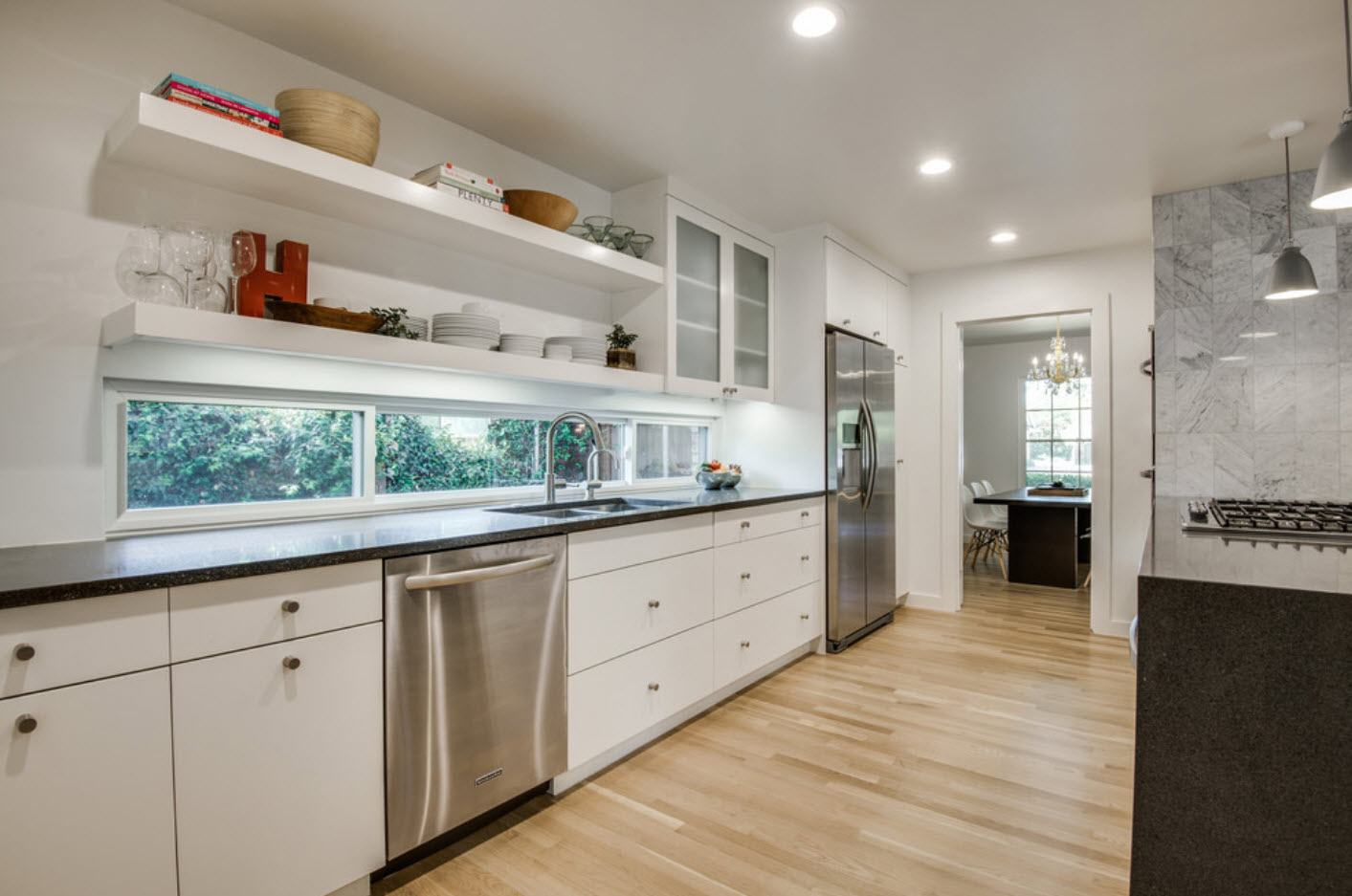 Minimalistic design of the galley kitchen with steel surface
