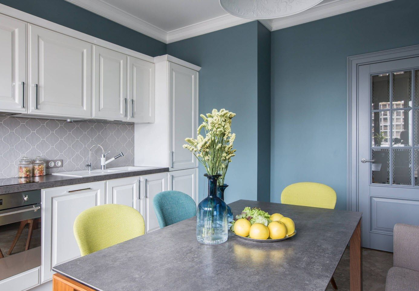 Blue wall and white Classic carved kitchen cabinets