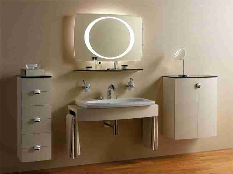 Beige colored bathroom with LED-lit round mirror