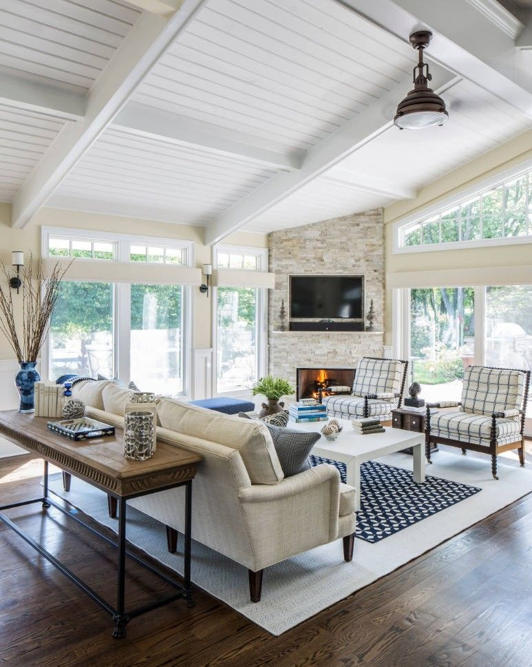 150 Square Feet Living Room Best Arrangement Ideas. Apparent rest zone in the middle of sunroom with carpet