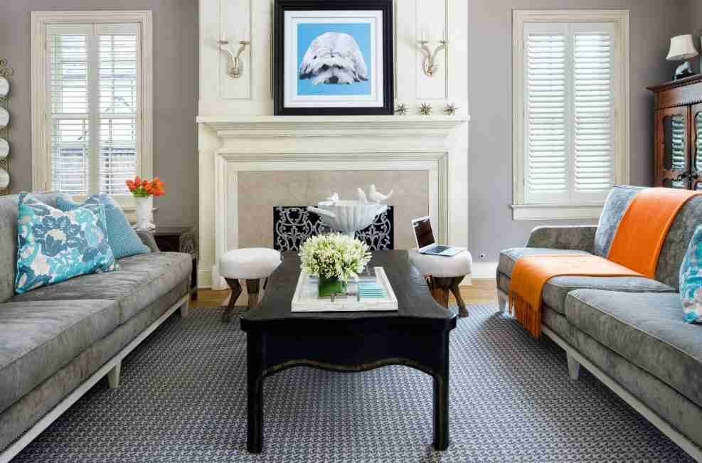 Ivory Interior Decoration Ideas, Photos, Advice. Classic American styled living with fireplace and dark wooden coffee table