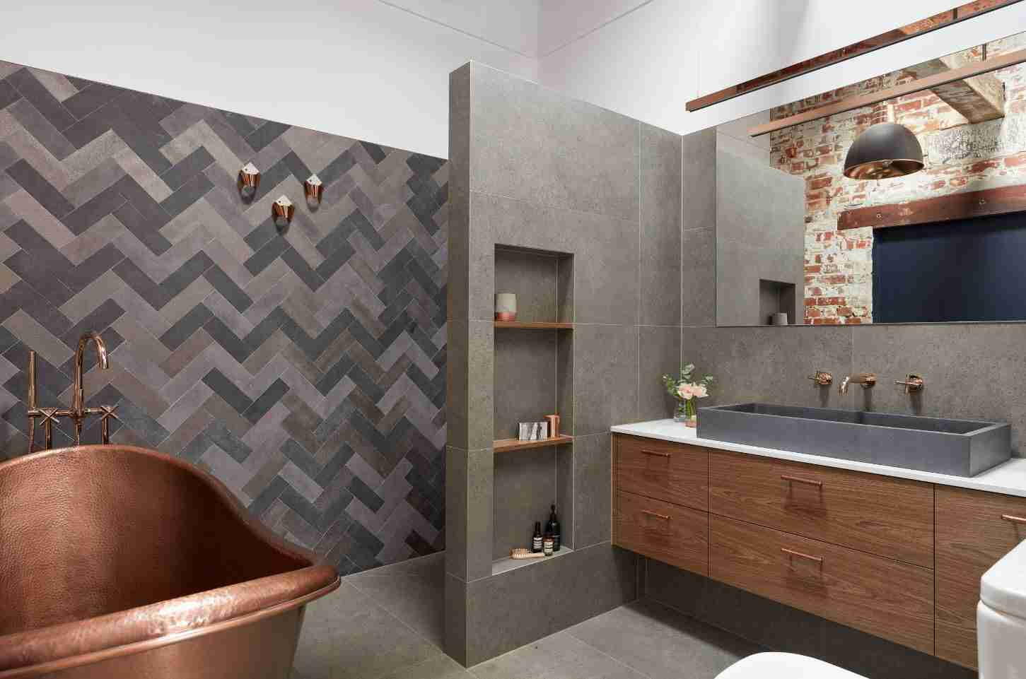 Gray bathroom with shelved in the false wall