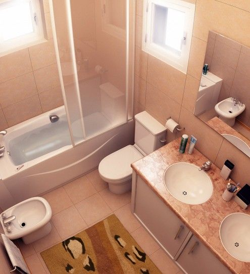 Beige colored bathroom with bidet, toilet and bathtub behind the glass screen