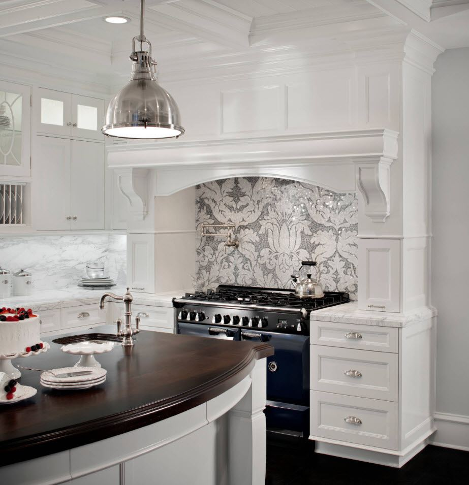 White kitchen with dark countertop of the island