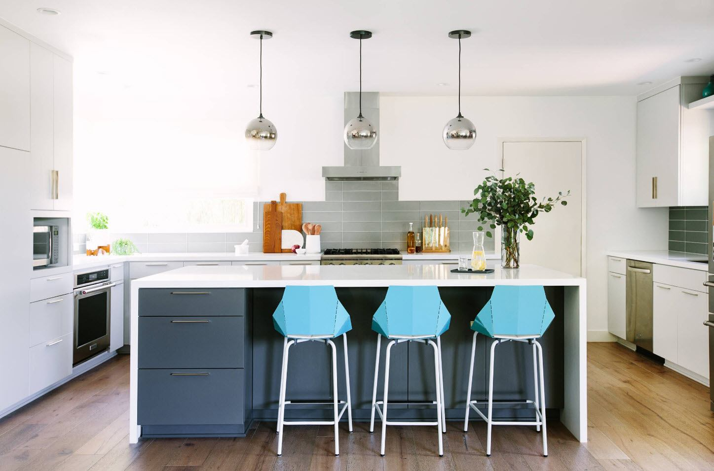120 Square Feet Kitchen Interior Design Ideas with Photos. Minimalist kitchen with pendant island lighting and plastic chairs