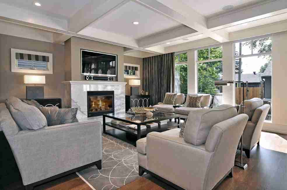 Ivory Interior Decoration Ideas, Photos, Advice. Coffered ceiling for American styled large living room with black metal and glass coffee table