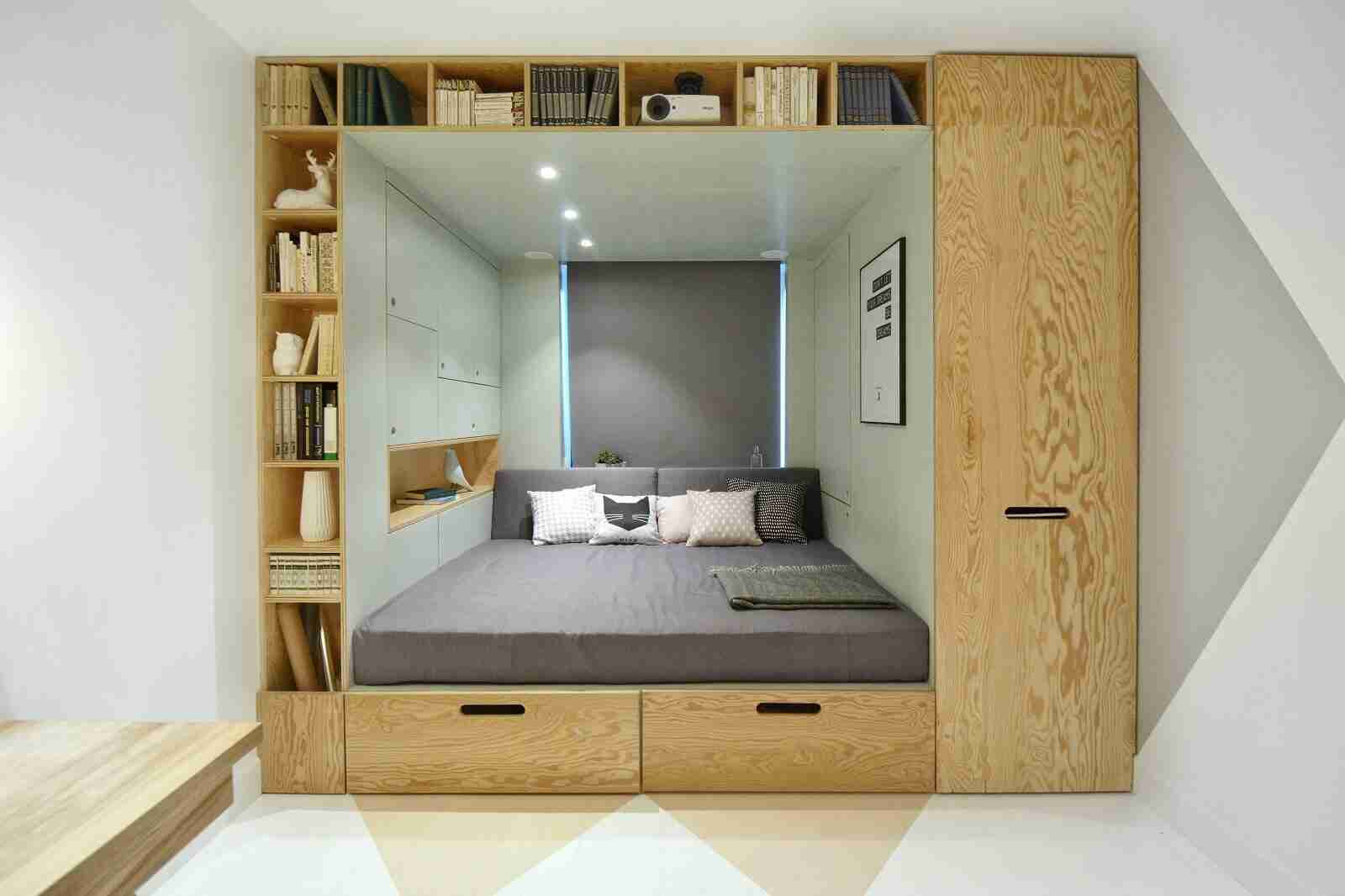 Library and the cozy sleeper all in one for modern designed apartment