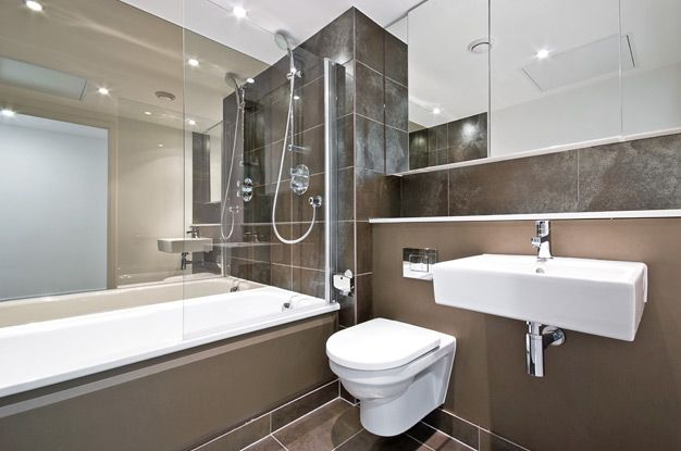 Modern bathroom with strict lines and glossy mirroring surfaces