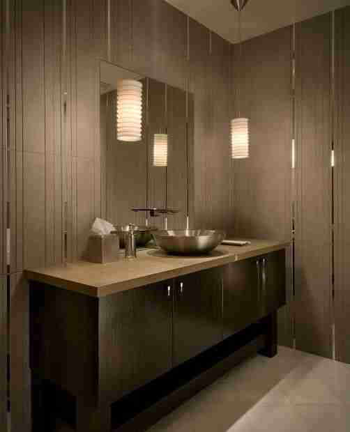 Bathroom Interior Lighting Ideas. Why is It So Important? Dark bottom tier of the vanity and light countertop in the contemporary bathroom