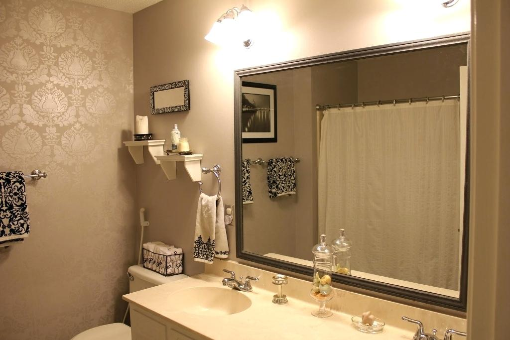 5 Simple Tricks for a Guest Bathroom Remodel. Beige tone in the modern bathroom with large mirror