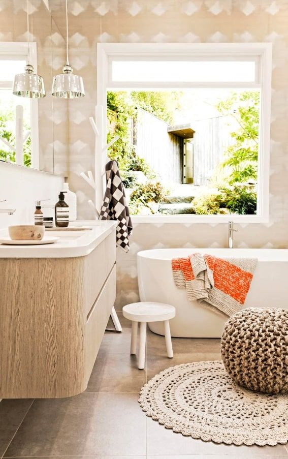 How to Design an All White Bathroom. Soft round ottoman