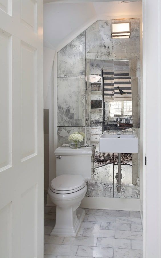 How to Design an All White Bathroom. Decorative mirrors all the wall long