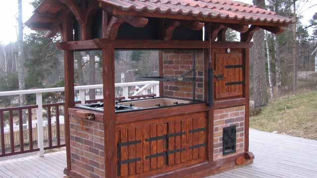 Charcoal grill with an awning.