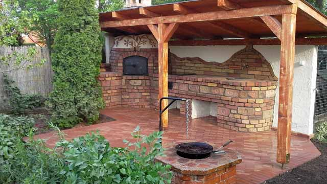 Pergola with open charcoal grill