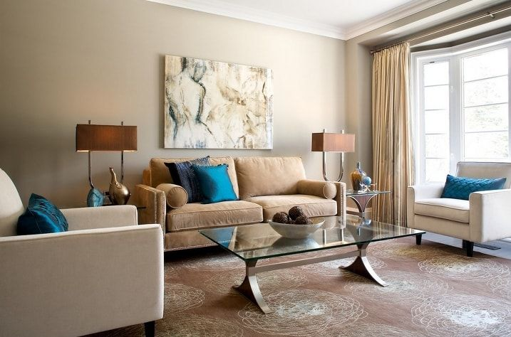 White ceiling and beige colored walls for the casual styled living room with glass coffee table