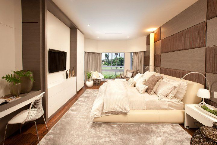 Low bed in the modern bedroom with mix of many colors