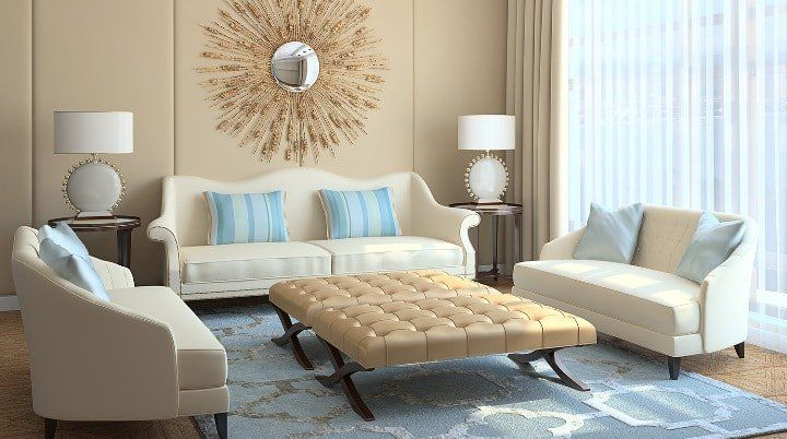 Beige Color Interior Decoration Ideas: Proper Combinations. Starburst mirror for modern designed living with folding quilted coffee table