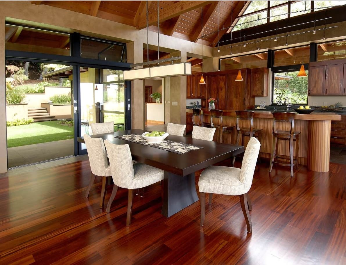 Tips for Keeping Your Hardwood Floors Clean. Glossy polished mahogany flooring in the large mansion