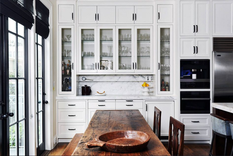Best Ideas on Tables and Chairs for Small Kitchen. CLassic white kitchen with rough wooden table and dark wooden chairs