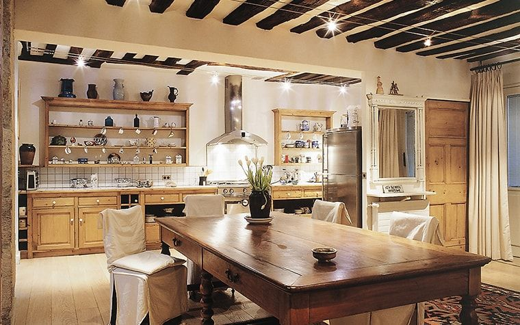 Italian Dining Room & Kitchen Combined in One Space. The piano keys looking ceiling with exposed beams and ivory tint of the interior color scheme